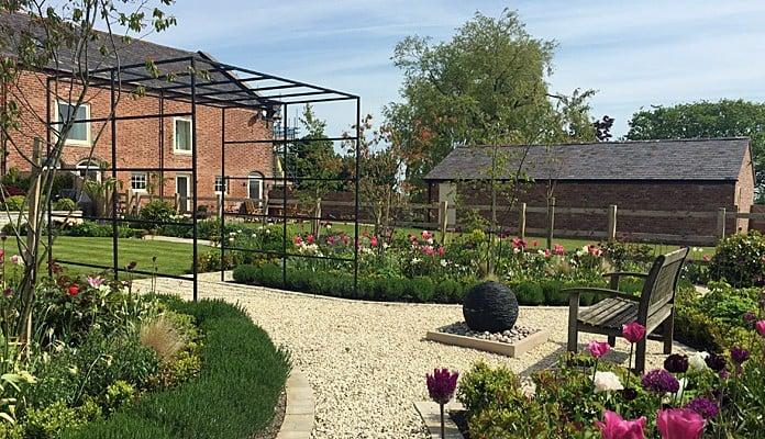 Daisy Barn Garden Square Pergola spanning central path