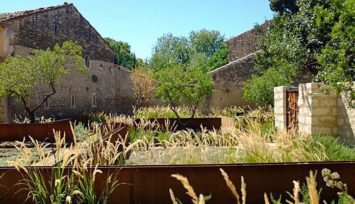 Canal Water Feature in St Remis de Provence.Achnatherum calamagrostis grass