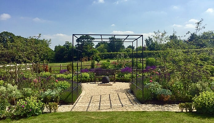 Daisy Barn Garden Square Pergola with climbing roses and clematis