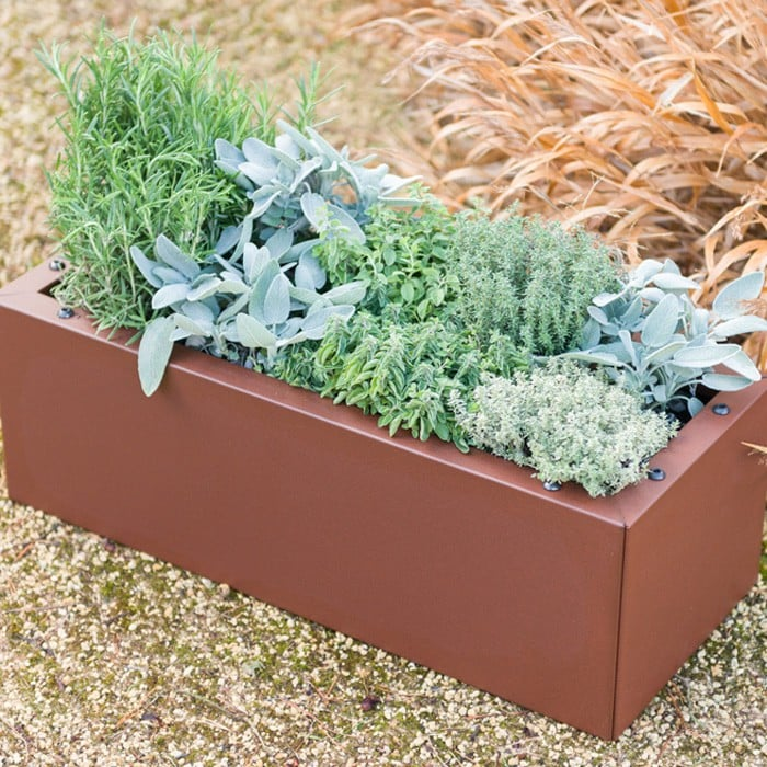 buy flowers gardeners with planters filled teak supply on planter trough box tiled patio estate wood