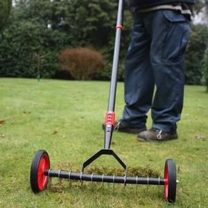 Lawn Moss And Thatch Have Every Right To Be Scared When This Highly Efficient And Operator-friendly Wheeled Lawn Scarifier Rolls Into Town Just Pull T