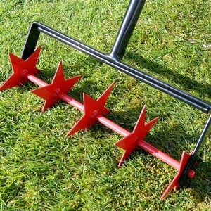 Made In The Uk From Heavy-duty Plastic Coated Steel This Rolling Lawn Aerator Is Easy To Use And The Innovative Design Of The Star Shaped Spikes Cut I